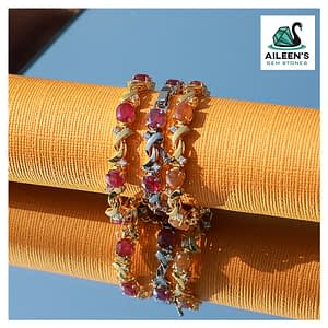 STUNNING OVAL CUT PINK RUBY AND YELLOW SAPPHIRE BRACELET WITH CUBIC ZIRCONIA STONES IN STERLING SILVER