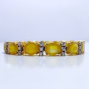 EXCLUSIVE OVAL FACET YELLOW CEYLON SAPPHIRE With ZIRCONIA, RHODIUM GOLD PLATED