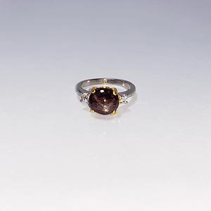Black star sapphire with zirconia