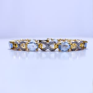 ROYAL SYNTHETIC CRYSTAL BLUE TOPAZ BRACELET WITH WHITE ZIRCONIA, RHODIUM GOLD PLATED