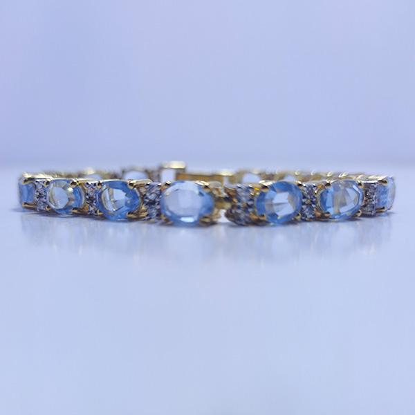 BLUE OVAL TOPAZ BRACELET WITH ZIRCONIA