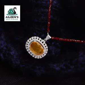 VINTAGE NATURAL YELLOW SAPPHIRE PENDANT, WITH AMERICAN ZIRCONIA HALO AND NATURAL HIMALAYAN RUBY STRING